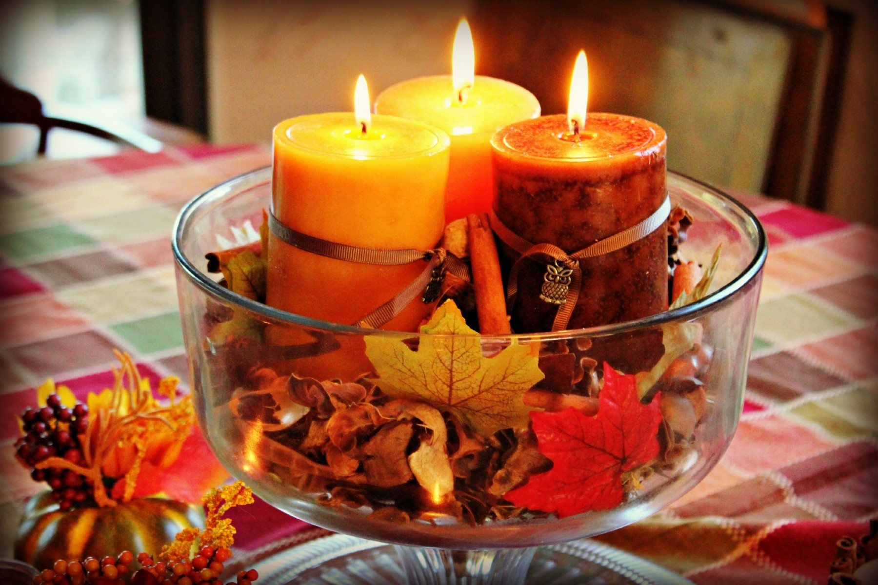fall themed candles on deck