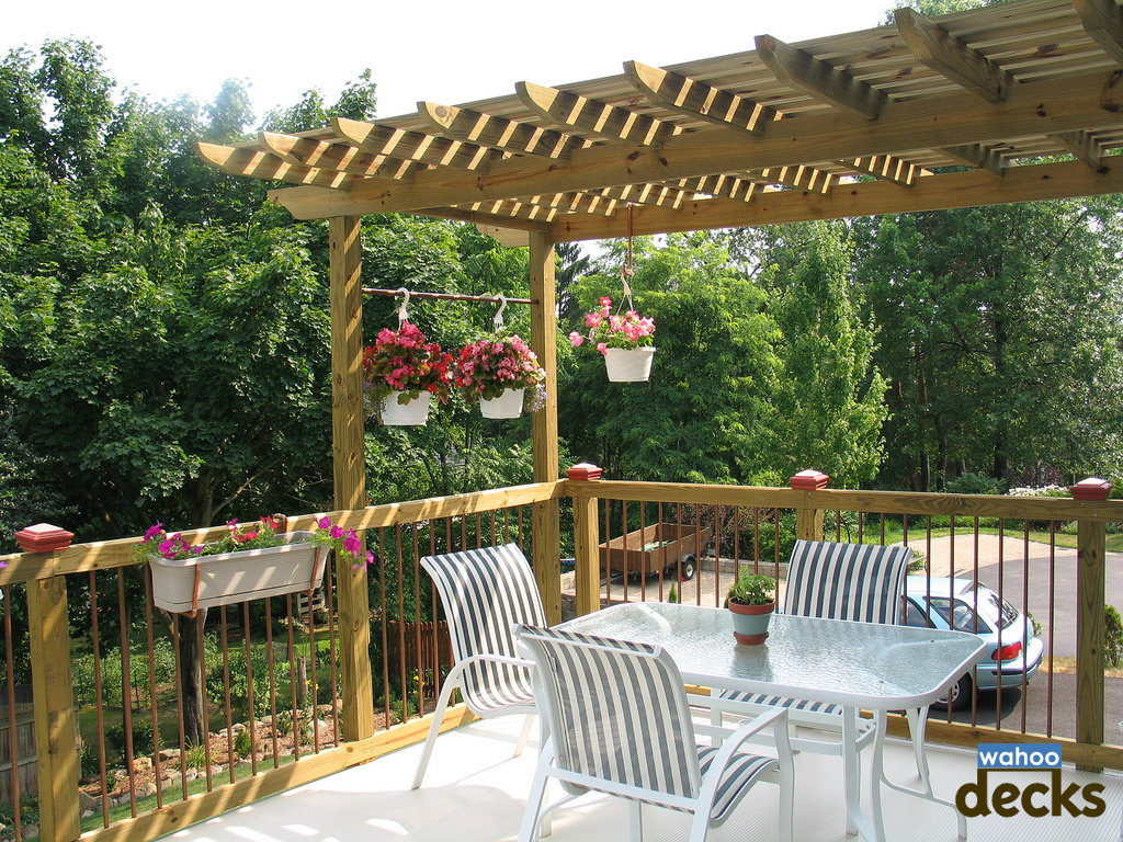 pergola with sitting area for your deck design